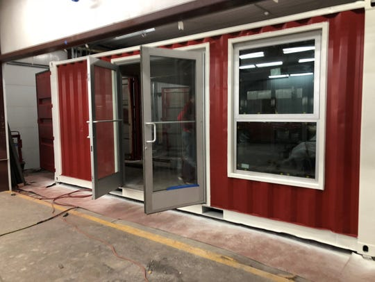 Cari and Matt Harrison purchased two shipping containers
