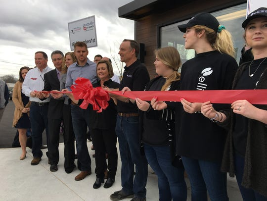 City leaders and employees cut a ribbon Thursday during