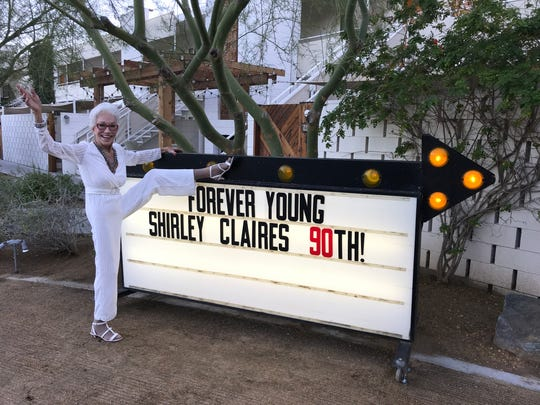 Shirley Claire kicks up her leg at her 90th birthday celebration at the Ace Hotel & Swim Club in Palm Springs on Jan. 11, 2018.