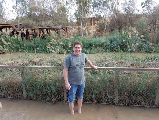 Ryan Fraser standing in the River Jordan.