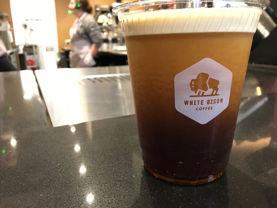 Get handcrafted nitro cold brew at White Bison Coffee inside Twice Daily market.