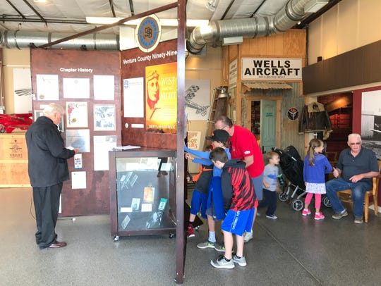 Visitors look at a display about women in aviation