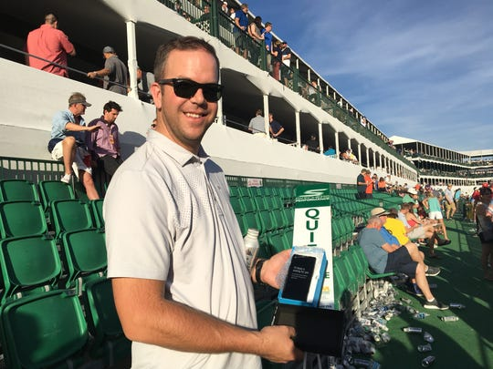 Golfer Danny Lee was among those who gave items to fans at the Phoenix Open's 16th hole. John Allen got a phone.