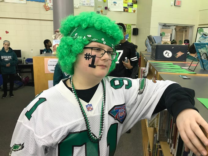 Jared Colan, 11, is decked out in green for Williamstown