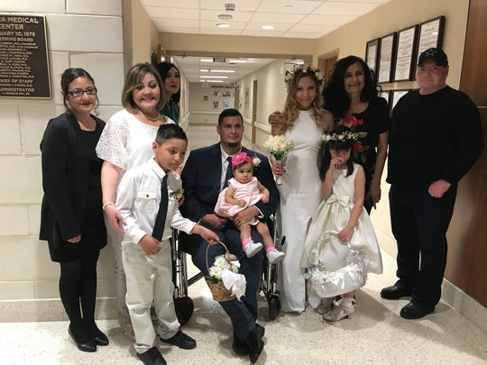 The bride and groom took pictures with family after their ceremony.