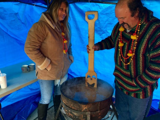 Doug and Amy Wilcox stir gumbo at the Gumbo Cookoff.