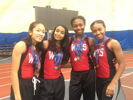 Catherine Catipay (left), Kaylah Davis (second from left) and Trinity Eason (third from left) earned All-Conference as members of Woodbridge's 4 X 400 relay team