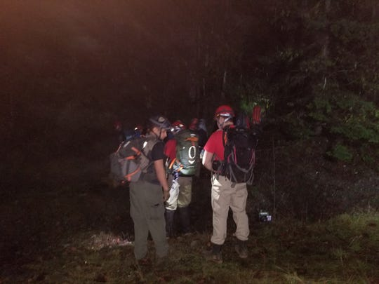 Eight climbers begin their ascent of mountain terrain near Henline Falls in the Willamette National Forest to rescue a missing hiker around 12:20 a.m. Sunday, Feb. 4, 2018.