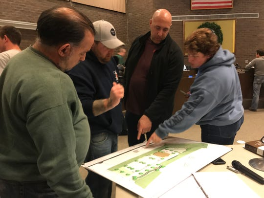 Residents examine blueprints for a shul in Jackson.