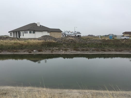 Construction of homes continues along Oso Creek — some