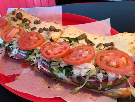 Among the favorites at GrinderVille is the Italian combo grinder with ham, salami, sausage, mushrooms, onions, green peppers, lettuce, tomato and mayo.