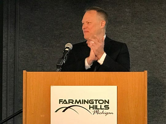 New Farmington Mayor Steve Schneemann applauds the efforts of city staffers at the State of the Cities event Wednesday.