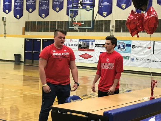 Tyler Mctigue, left, and Tanner Clabaugh signed for