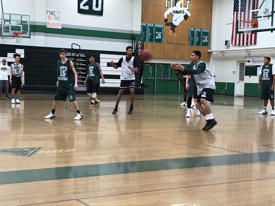 The Hug boys basketball team practices Wednesday at