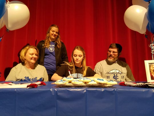 Wichita Falls High School senior Kori Hopkins signs to play volleyball for Vernon College during National Signing Day on Wednesday.
