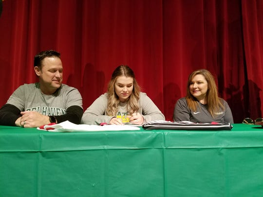 Wichita Falls High School senior Grace Laukhuf signs to play volleyball at Belhaven University during National Signing Day on Wednesday.
