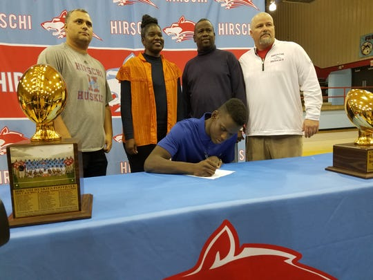 Hirschi senior Ezekiel Holmes signs to play football for the Illinois Fightin' Illini during National Signing Day on Wednesday.