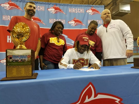 Hirschi senior Gerrick McKinney signs to play football at Midwestern State during National Signing Day on Wednesday.