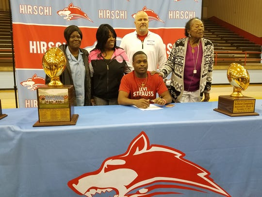 Hirschi senior Isaiah White signs to play football at Oklahoma Panhandle State University during National Signing Day on Wednesday.