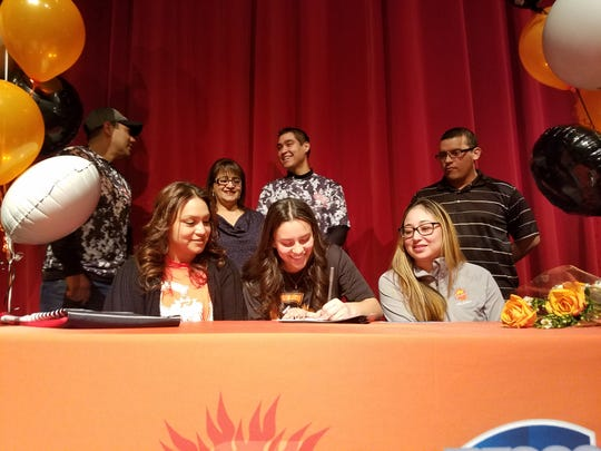 Wichita Falls High School senior Amaya Saenz signs to play volleyball at Cedar Valley College during National Signing Day on Wednesday.