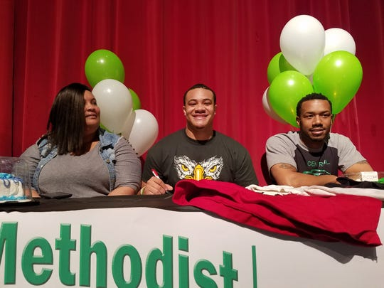 Wichita Falls High School senior Ca'Maurie Johnson signs to play football a Central Methodist University during National Signing Day on Wednesday.