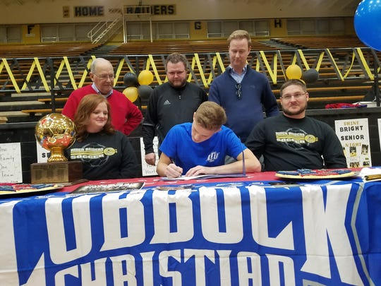 Rider senior Blake Beasley signs to play soccer at Lubbock Christian University during National Signing Day on Wednesday.