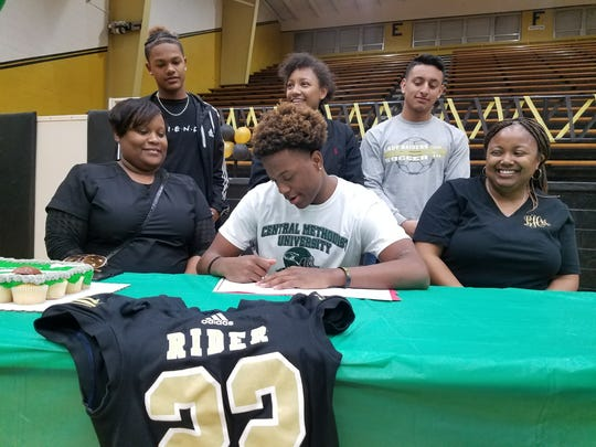 Rider senior Brandon Bolton signs to play football at Central Methodist University during National Signing Day on Wednesday.