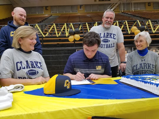 Rider senior Payton Ernest signs to play football at Clarke University during National Signing Day on Wednesday.