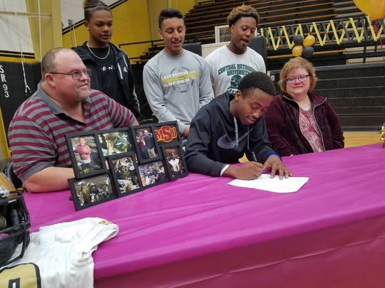 Rider senior Jake Edgemon signs to play football at Midwestern State during National Signing Day on Wednesday.
