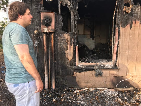 Wyatt Crane stands by the room where the fire was thought