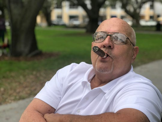 In this Tuesday, Feb. 6, 2018, photo, John Wall, 65, who semi-retired and keeps a part-time job with a rideshare app to help pay bills, talks about how he won't be able to retire in St. Petersburg, Fla. He lost money in his investments during Monday's dip in the stock market. (AP Photo/Tamera Lush)