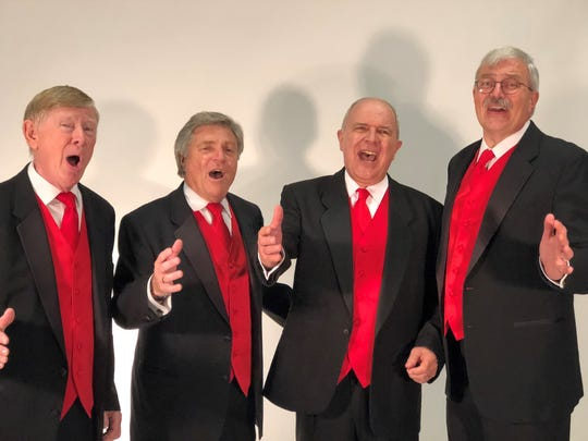 A Gulf Coast Harmonizers quartet performs a singing valentine at The News-Press photo studio. Pictured are Chuck Solomon, Larry Cunningham, Clint Cottrell and Barry Bowers.