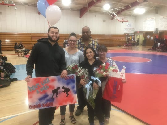 Carolina Johnson (second from right) celebrates senior night against Monterey following her Central Coast Section title.