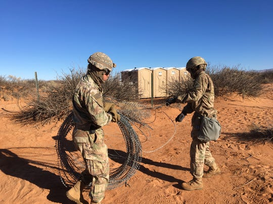 Soldiers put up concertina wire to secure 2-13 Cav's headquarters area during Bulldog Focus.