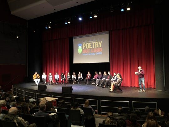 Teaneck poet, Howard Berelson, who just won the Ginsberg Poetry Prize in Paterson, recites a poem at a poetry festival in Bergen County College i Paramus, NJ on Friday.