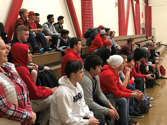Wooster baseball players listen to new coach Mike Terry on Friday..