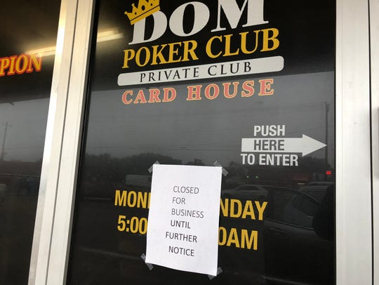 A sign announcing the closure of Kingdom's Poker Club