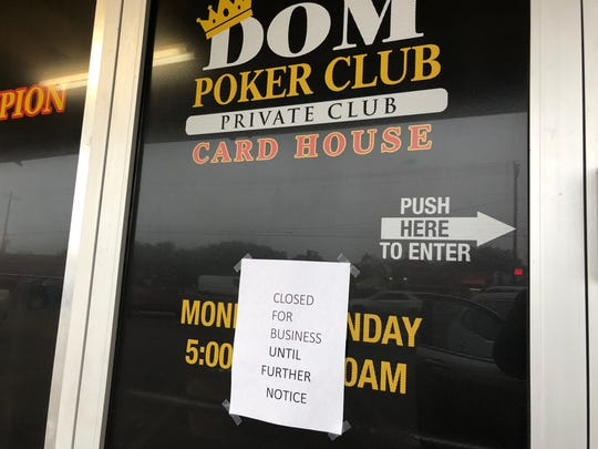 A sign announcing the closure of Kingdom's Poker Club in Kingsville remains taped on the front door on Wednesday Feb. 7.