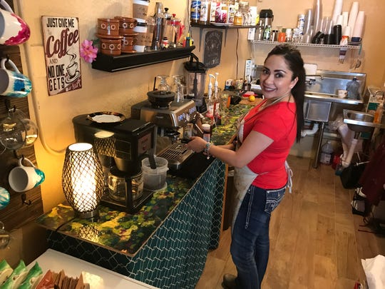Erica Murrill, owner of Cafe Arte Mi Admore, makes some coffee for customers Saturday. The artist has been at the San Elizario Art District for a few months.