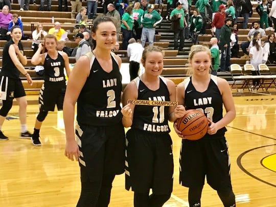 Winchester's three captans Maddie Lawrence, Tori Pegg and Hannah Graft pose after winning the regional championship over Triton Central on Saturday at Speedway.