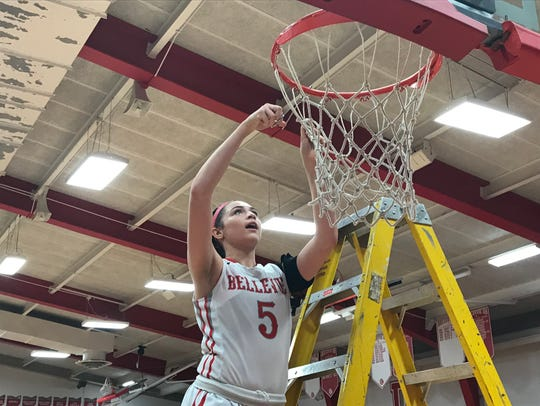 Gabby Turner helps cut down the net to celebrate a