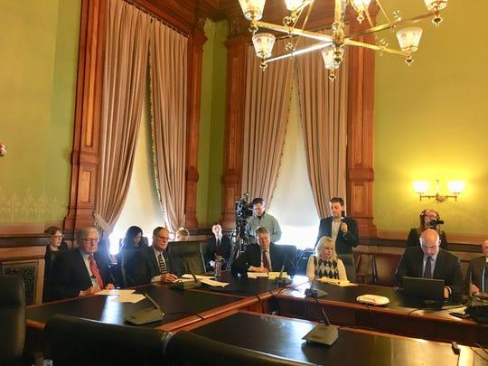 Members of an Iowa Senate subcommittee and legislative