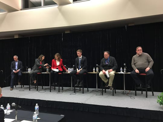 Third Congressional District Democratic candidates, from left, Eddie Mauro, Theresa Greenfield, Cindy Axne, Austin Frerick, Paul Knupp and Pete D'Alessandro appeared at a forum at Simpson College on Tuesday night.