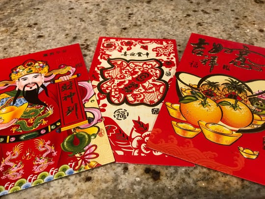 Red envelopes with money for kids