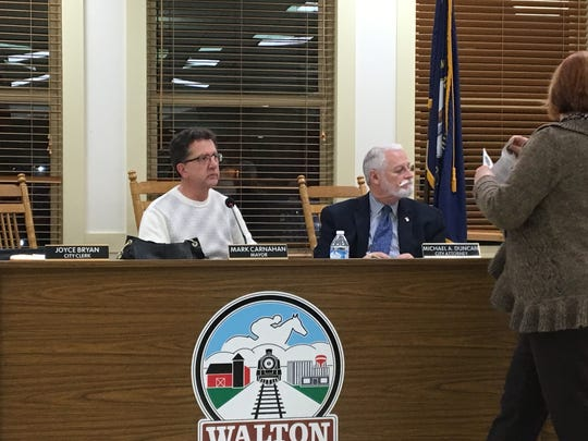 Walton Mayor Mark Carnahan, left, watches as the city clerk prepares for the Feb. 13 city council meeting a week after he walked out in the middle of the last council meeting. The walkout came after he was presented with a letter by council members alleging he has acted improperly as mayor.