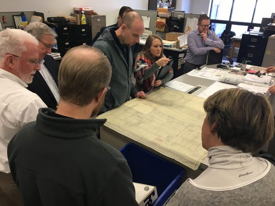 Developers look at the original blueprints of the Argonne Armory Building.