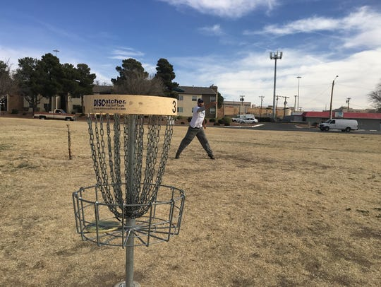Disc golfer Victor Villalobos lines up for a shot at