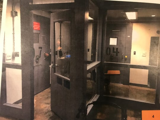 A red sign indicating a juvenile is housed there hangs over a cell where Teriyona Winton was housed at the Tennessee Prison for Women. While at the prison, she showered three days a week, and teachers instructed her through the flap in her door.