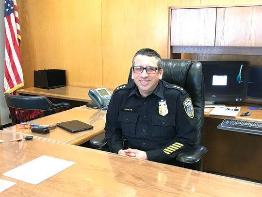 Assistant Chief James Harpole sits at his desk at Milwaukee