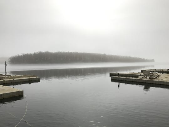 Fog lifts off a thawingGreenwood Lake in West Milford, N.J. as temperatures approached 60 degrees on Feb. 15, 2018. Viewed from the west shore of the lake with view of Fox Island.
